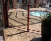 Large Ashler with Stone Skin Border Stamped Concrete Pool