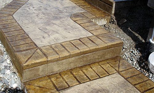 Slate Skins with Brick Border Stamped Concrete Walkway